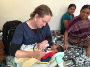 Christine Platt cares for Guatemalan baby in her recent internship.