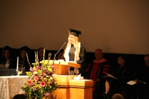 Mary Raymer speaking at the August college convocation.